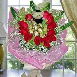 11 Red Roses with 9 Ferrero Roche and  Graduation Bear Hand Bouq