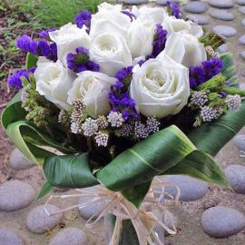 12 White Roses With Cordyline Foliage Hand Bouquet.