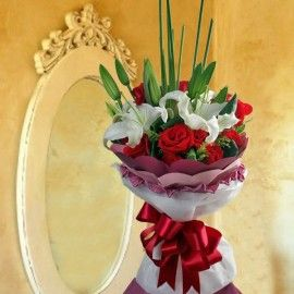3 Lilies & 12 Red Roses Hand Bouquet Special Design