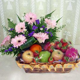 Mixed Fruits and Pink Gerberas Arrangement