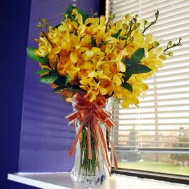 Yellow Mokara Orchids in Glass Vase