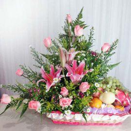 Pink Lily and Roses Fruits Basket Arrangement