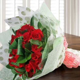 20 Red Roses With Cordyline Foliage Hand Bouquet