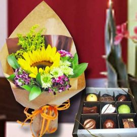 Small Sunflower Handbouquet and Chocolate.